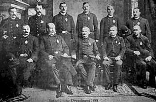 Black and white photo of uniformed men